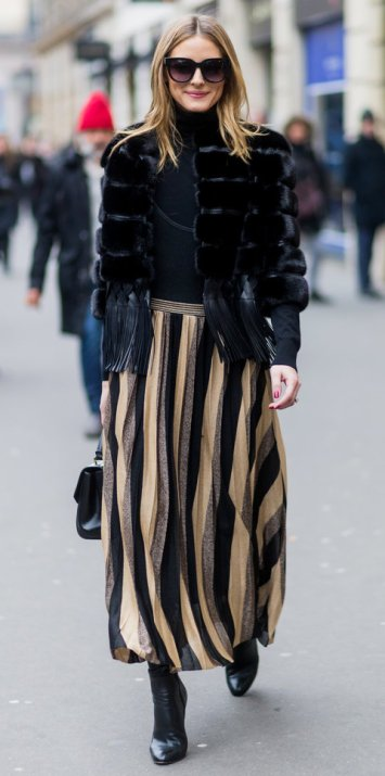 PARIS, FRANCE - JANUARY 25: Olivia Palermo wearing a black fur jacket, striped skirt outside Elie Saab on January 25, 2017 in Paris, Canada. (Photo by Christian Vierig/Getty Images)